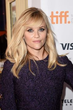 Reese Witherspoon sporting a purple smoky eye and the best blowout ever!
