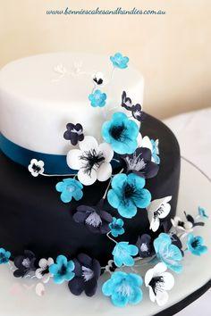 Black-white-and-blue-icing-flower-blossoms-cascading-over-black-and-white-engagement-cake-Bonnies-Cakes-Kandies-Gympie-Rainbow-Beach-Maryborough-Sunshine-Coast.jpg (563×846)