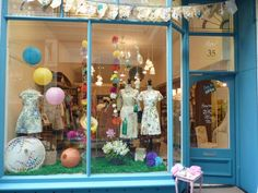 Quirky, vintage inspired summer floral window shop display