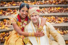 Bride and groom portrait on their wedding day. Love the bright colors and fall leaves! #indian #wedding #photography