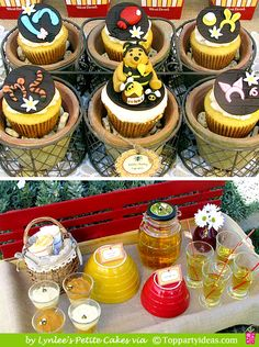 Even more pictures from the party by Lynlee's Petit Cakes. This time the picnic basket jumped out at me and the butterscott pudding cups next to the red & yellow flowerpots that are upside down.