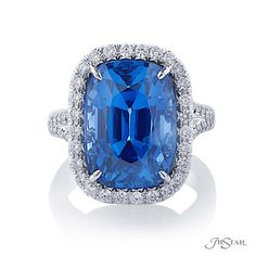 Spectacular sapphire and diamond ring featuring a magnificent 16.69 ct. GIA certified Sri Lankan cushion sapphire center surrounded in round diamond micro pave