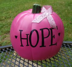We love this pink breast cancer awareness pumpkin