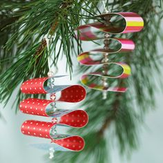 Ribbon Candy Ornaments  Create ornaments that resemble classic ribbon candy. Thread a needle with embroidery floss and knot at one end. Thread on one clear acrylic bead, then poke the needle through the end of a 1-inch-wide paper strip. Thread on two more beads and loop the paper (as shown). Poke the needle back through the paper. Repeat until the entire paper strip has been looped. Finish by running the floss twice through the top bead and make a loop for hanging.