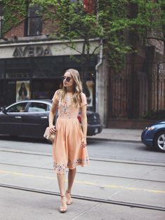Short sleeve peach dress with floral embroidery + nude accessories