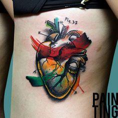 Tattoo Szymon Gdowicz coração aquarela