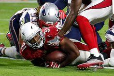 Arizona Cardinals running back David Johnson (31) scores a touchdown as New…