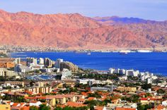 Eilat - city in South Israel at the Red Sea. In front of the city, you can see Akaba in Jordan and the mountains of the Arabic Peninsula