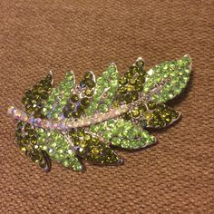 "Green leaf brooch with crystals brand new About 2 1/2"" long classy modern brooch. Brand new. Shades of green Jewelry Brooches"