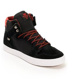 A guys high-top Zumiez exclusive black and red buffalo plaid colorway with a durable black suede upper, black corduroy side walls and back heel, vulcanized construction with a durable white rubber outsole, double stitched perforated toe cap and abrasion a