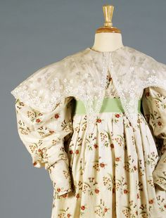 Day dress of printed cotton worn with whitework collar, 1830s, KSUM 2002.35.3 (dress) and KSUM 1983.1.2175 (collar).