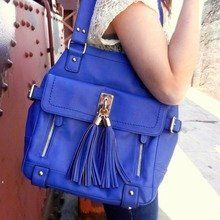 Love everything about this bag. Especially the pop of color...!