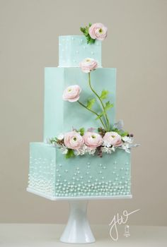 This is my contribution to the flowers issue of Wedding Cakes and Sugar Flowers Magazine. The cake features the Ranunculus flower made from gum paste. As this flower is an old bloom, I wanted to create a modern cake with a vintage flair. The color. Beautiful Wedding Cakes, Gorgeous Cakes, Pretty Cakes, Cute Cakes, Amazing Cakes, Beautiful Flowers, Modern Cakes, Unique Cakes, Elegant Cakes