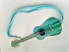 Handmade stain glass guitar by Beth. Found at Textures Craftworks Hamilton ON