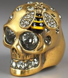 Am at once fascinated and disgusted with this skull and bee ring.  It's too weird to be called ugly so should we say it's… comical?  I kind of like it and the price is not totally outrageous.  Will need to go to the McQueen store in NYC to check it out in person.