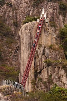 Suspended above the massive and foreboding ravines in Daedunsan Provincial Park in South Korea, the visitor bridges and ladder-like walkways make for an adreneline-filled experience Places Around The World, Around The Worlds, Scary Bridges, Dangerous Roads, Scary Places, Pedestrian Bridge, Stairway To Heaven, Golden Gate Bridge, Stairways