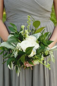 White ranunculus and greenery: http://www.stylemepretty.com/2015/03/16/rustic-chic-vineyard-wedding-2/ | Photography: Sweet Monday - http://sweetmondayphotography.com/