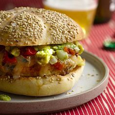Everyone will love these Chicken Burgers With Guacamole, Cheddar, and Charred Tomatoes | health.com