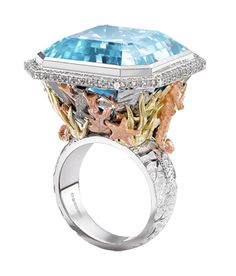 Theo Fennell - Under the Sea Ring, finely detailed fish, seahorses and coral surround the 44.87ct Blue Topaz.