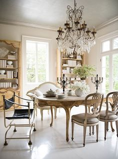 French dining chairs, a gilded carved leg oval dining table, ivory love seat and oversized crystal chandelier make for a seriously glamorous dining room! European Home Decor, French Country Dining, Dining Room Design, Dining Room Furniture, Country Decor, European Style Homes, Mixed Dining Chairs, Dining Room Decor, French Dining Chairs