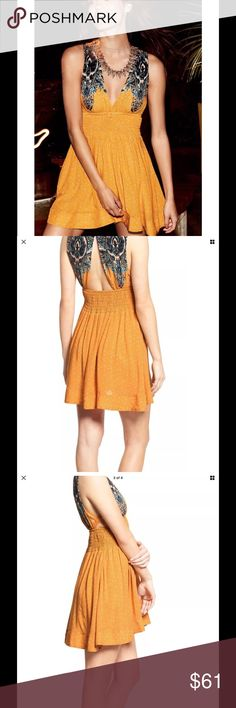 """Free People Walking Through Dreams Dress orange Size large New without tags A playful mix of prints and a fit-and-flare silhouette make this breezy dress a warm-weather essential. Styled with a plunging neckline and crisscrossing straps on the side, the lightweight look is flirty and fun. 35"""" length  Slips on over head. Free People Dresses Mini"""
