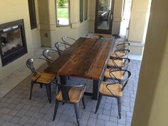 """This Reclaimed Wood and Steel Outdoor Dining Table was custom built to 95""""x40""""x30"""".  Designed and built to seat 10 people, it is constructed out of Douglas Fir reclaimed from a Wisconsin barn."""