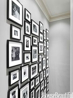 In the stairwell, matched frames unite multigenerational family photos.