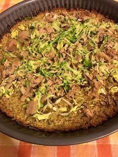 ricetta 200 gr di quinoa cotta e lessata, un uovo ,sale, impastare la quinoa con l'uovo e il sale preparare una teglia unta e ricoperta con carta fo