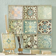 scrapbook paper and dollar store frames. I'm trying this!!!....good for the bathroom!