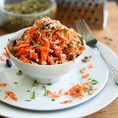 Simply the best carrot salad you will ever have.  But leave out sweetened dried cranberries be try raisins instead