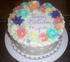 The name gudiya is generated on Colorful Flowers Birthday Cake
