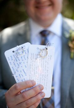 Tie your wedding rings to handwritten vows on notecards | Brides.com