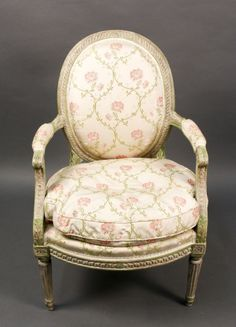 Louis XVI Style Carved & Polychrome Fauteuil French, Late 19th/Early 20th century. Louis XVI style carved and polychromed wood fauteuil or armchair with distressed grey and green finish on frame with lappet, acanthus leaf and egg and dart motif throughout with tapered fluted legs under floral patera blocks