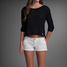 summer night outfit. a black belly-bearing shirt.