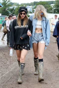 Glastonbury Street Style: A Lesson In Looking Good While Covered In Mud #refinery29  http://www.refinery29.com/2016/06/115099/glastonbury-festival-street-style-2016#slide-3  Another #dreamduo. Models Lily Donaldson and Suki Waterhouse pair mud-splattered Hunter boots with double denim and all-black everything, respectively....