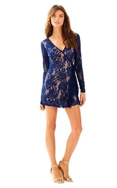 The Tiki Wrap Romper takes the classic wrap dress and gives it a twist. This long sleeve lace romper dress has an asymmetrical front skirt, and looks like a classic romper in the back.