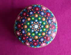 Hand painted Mandala Stone using acrylic paint and protected with Matt varnish.  Its a beautiful white glacier granite stone, almost perfectly rounded by nature.  This is one of a kind stone and is about 8,5 cm long.  Please leave me a message if you have any questions.  The stone is ready to ship within 1-3 business days using DHL with tracking number