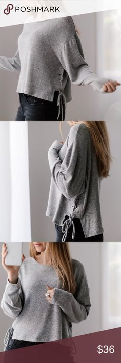 """Softest Lace Up LS Too cute lace up LS. My popular super soft material in heather gray, feels and looks like cashmere. This top can be dressed up or down. I love the playful shorter length! Wearing with my Rosé Jeans.  ▫️Material: Rayon, poly, spandex ▫️Fit: Casual ▫️Chest across: S 20"""" M 20.5"""", L 21"""" ▫️Front length: S 17"""" M 17.5"""", L 18"""" ▫️I am modeling S ▫️Brand new  Price is firm, 10% off bundles of 3+  📷Photos are my own 11thstreet Tops"""