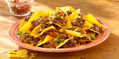 Serve HORMEL® Chili with a crunch! Whip up these Chili Nachos and add your favorite toppings for a quick and easy game-day snack.