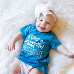 """Nothing makes me more beautiful than my confidence and strength."" I am loving this little doll face in her custom color T-shirt!"