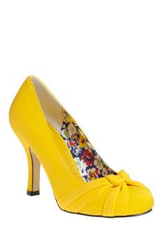 Bright yellow shoes for spring and summer! Love the cute little bow on top and the pretty little flower fabric inside for a little extra fun! :-)