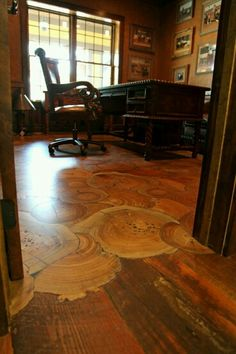 Rustic floor. Very nice. Love the transition from traditional to round cut flooring.
