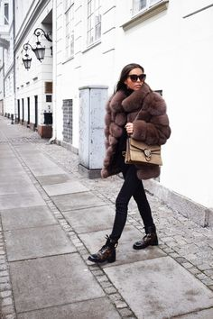 Fur coat from iFur Copenhagen ( here ), Jeans from Zara, Knit from H&M, Boots from Louis Vuitton, Belt from Gucci, Bag from Gucci and Sunglasses from Gucci