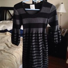Adorable striped sweater dress w/ 3/4 sleeves Black and gray striped sweater dress. Perfect to wear with leggings. Ties in back.  Sleeves puff out at bottom. So cute! Only worn twice. So soft! Pink Rose Dresses Mini
