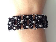 A personal favorite from my Etsy shop https://www.etsy.com/listing/225098649/black-and-silver-chainmaille-bracelet
