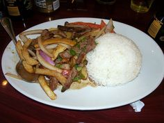 Lomo saltado *serve over sauteed veggies and greens & a side of platanos, omit fries/rice and sub coconut aminos for soy sauce... super good!