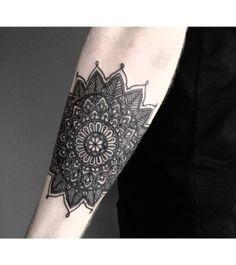 Dark black mandala tattoo