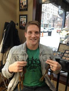 AJ Hawk showing off his new look and donating the hair to someone who needs it more than he does.