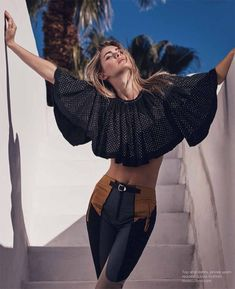Photographed outdoors, Megan models a Louis Vuitton crop top and high-waist pants for Luxury Magazine march 2016 issue