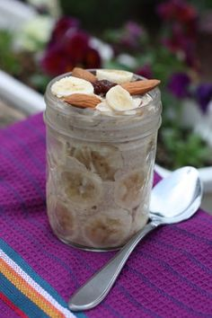 overnight breakfast quinoa:  1/2 cup rolled oats  1/4 cup quinoa flour**  1 cup almond milk, or other non-dairy milk  1 scoop vegan vanilla protein powder (I use Sun Warrior)  1/4 cup sliced almonds  1/4 raisins  1/4 t vanilla  1/2 t ground cinnamon  sliced banana, for topping